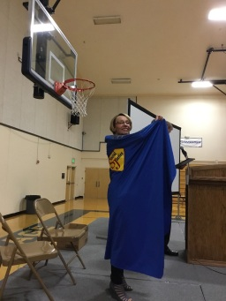 Peggy Edwards receives her Social Justice SuperHero cape