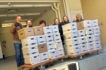 Library staff with 120 boxes of books from the Storey County Community Library's collection, which the Lyon County library system kept in safekeeping.